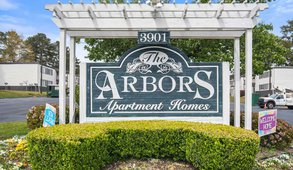 The Arbors Apartments sign